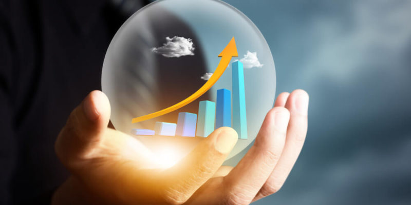 Person holding a crystal ball to illustrate a cash flow forecast.