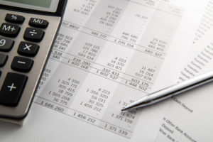 Financial documents and a calculator.