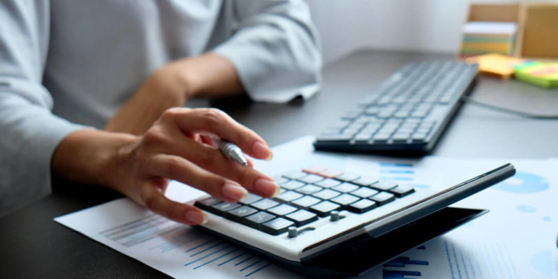 Person calculating employee retention tax credits.