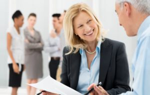"""Business people talking to illustrate """"What Does a CFO Do?"""""""