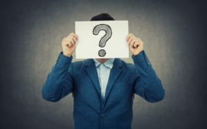 Business person with question over their face to illustrate the questions to ask a CFO in an interview.